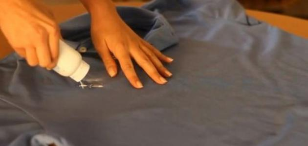 صورة ازالة بقع الزيت من الملابس , كيف اتخلص من بقع الزيت تنظيف الملابس